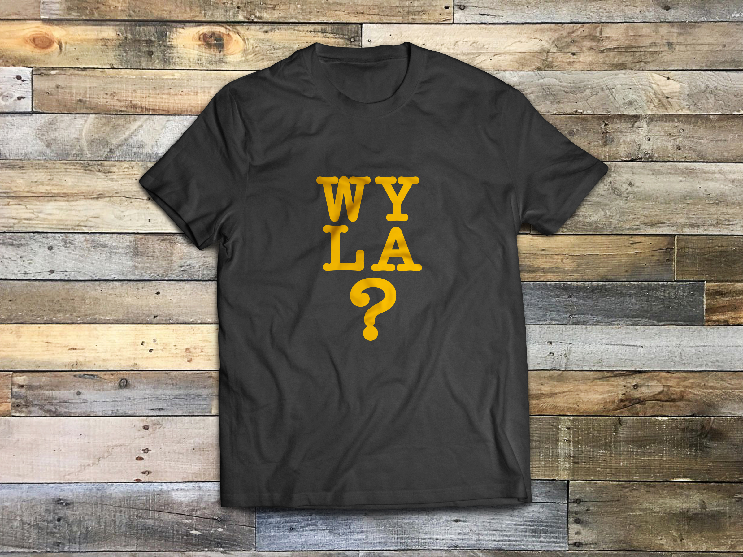 Black crew neck t-shirt with yellow/gold letters, wyla? on the front